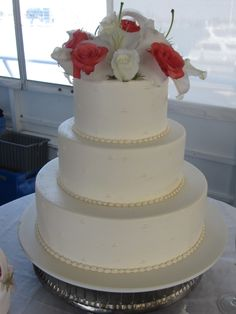 white and coral cake flowers