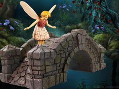 A mini fairy admires the new bridge in the fairy garden.