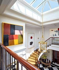 At this New York City duplex, John B. Murray Architect and interior design firm @cullmankravis transformed the entrance hall, where an expanded skylight now illuminates an impressive art collection. Photo by @joshuamchughphotography