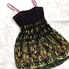 "Anthropologie Purple & Green Boho Dress Faux suede bodice with smocked elastic back, green layered skirt with vintage pattern, skinny adjustable straps. Excellent condition! Bust: 15"", Waist: 12 1/2"", Length: 27"". Anthropologie Dresses"