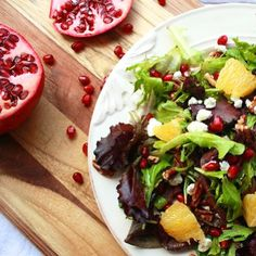 Pomegranate, goat cheese, orange and pecans make for a pretty festive holiday salad. On blog now! #fodmap #fodmaps