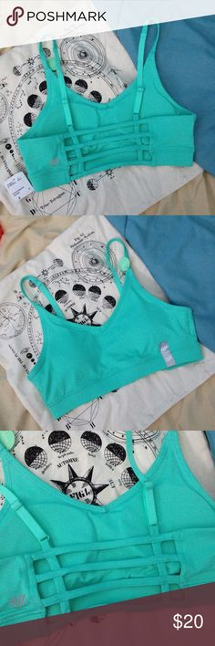 NWT Caged Back Sports Bra Brand new with tags attached. Caged ladder back sports bra. Adjustable straps. Moisture wicking fabric. Removable cups. Reflective logo on back. Gorgeous bright seafoam green color. This could actually double as a festival top as well. Forever 21 Intimates & Sleepwear Bras