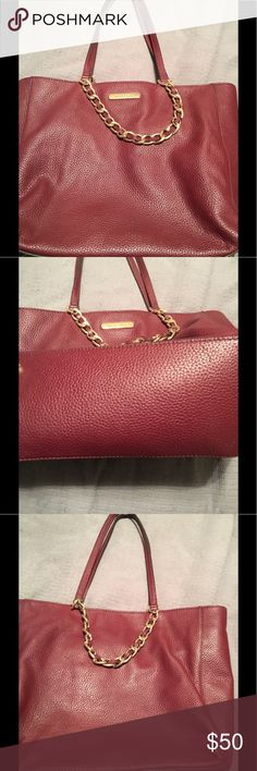 Burgundy shoulder bag Very cute gently used burgundy shoulder bag.  Some wear and tear but only noticeable close up, as seen in photos.  Has been used so leather is a little worn but still great looking bag Michael Kors Bags Shoulder Bags