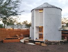 Architect Christoph Kaiser converted an old 1950s grain silo into a gorgeous tiny home for him and his wife in Phoenix, Arizona.
