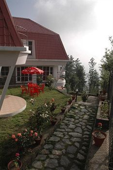 The Marigold Cottages with Shimla hills in the backdrop