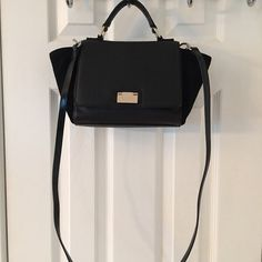 Kate Spade Black Leather Trapeze Satchel Bag Gold hardware.  Flap lock closure.  3 interior pockets (1 zips).  Leather and suede.  Like new.  Strap is not original to bag.  Measures: 8.5x3x7.5z3.5x22.5. kate spade Bags Satchels