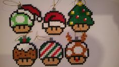I am selling a 6 handmade Super Mario Christmas ornaments presented in a box, perfect for any Super Mario fan or a perfect Christmas gift.  The box is 8 1/2in wide and 4in tall and is made from strong cardboard. The ornaments are 3 1/2in to 4 1/2in long and 3in wide and are made using Hama beads.  The decoration will come unassembled and packaged securely to avoid any damage during posting.  Thank you for having a look and check out my shop for more Pixel art.