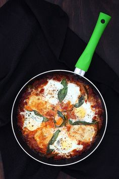 Shakshuka - breakfast eggs, cooked in a spicy tomato sauce and mopped up with crunchy bread. Breakfast Dishes, Breakfast Recipes, Snack Recipes, Morning Food, Sunday Morning, Shakshuka Recipes, How To Peel Tomatoes, Spicy Tomato Sauce, Easy Eat