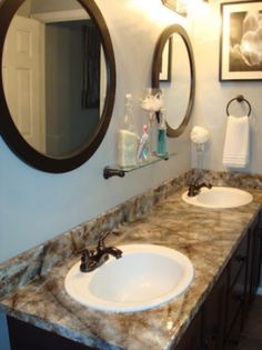 Ugly Laminate counter tops to gorgeous granite look with paint and sponges!  This website sells kits that incl. sponges for under $80!   http://gianigranite.com/