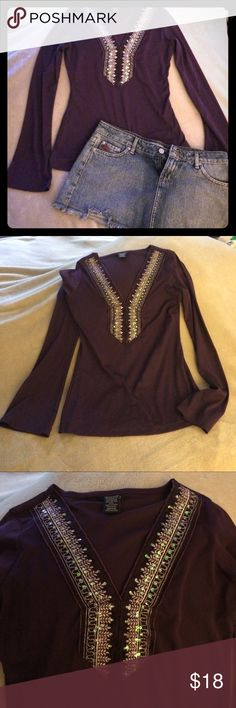 Vintage plum sequined v-neck top Vintage boho chic! Pictures do not do this shirt justice, it is a deep purple sheer long sleeve top. V-neck is embellished with gold stitching and sparkling sequins that give an iridescent pearl reflection. 100% polyester. EUC, wore a few times then folded into hiding lol. Paris blues size 3 Jean skirt can be excluded if you desire.  Make an offer! Will model in better light if necessary. ✨✨ Tops Blouses