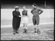 Arsenal paid Sheffield Wednesday £9000 for George Drury in 1938, and he is welcomed by Arsenal manager, George Allison and centre half, Herbie Roberts, at his arrival at Arsenal's ground Highbury.
