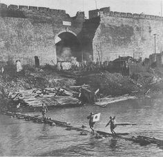 On this day in history - 13 December 1937. Japanese soldiers crossed a river near the Nanjing city wall China.