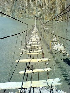 #Gojal, Upper Hunza - Suspension bridge crossing in the rocky valley in Gojal, upper Hunza, Pakistan. Need we say something more? Crossing it can turn out to be the biggest dare of your life.