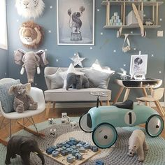 Lovely boys room - boys bedroom ideas and inspiration - blues, lovely prints , animal theme, star cushions