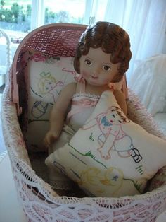 little dolly and her cute embroiderd pillows - available at fabric stores.