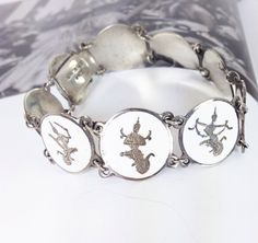 Vintage 1940's Siam Sterling silver Goddess bracelet. White enamel and featuring the Thai goddess Ramakien. A personal favorite from my Etsy shop https://www.etsy.com/listing/467766122/vintage-sterling-silver-siam-goddess