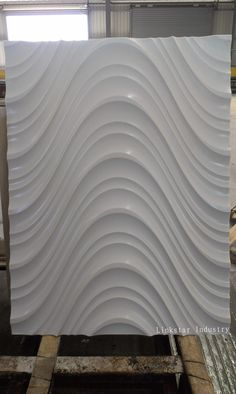 3D wavy stone wall tile pattern can create a fashionable architectural feel to the space at few cost.