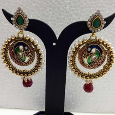 Peacock polki earrings with green, maroon and white stones - Rs 738.00