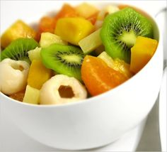 Tropical fruit salad with kiwi, tangerines, lychee, mango and pineapple.