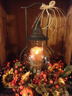 """This arrangement measures 22""""x18"""". It includes a motion flame timer candle, Steeple Lantern, and fall ring."""