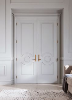 Carved white doors / brass hardware / color inspiration / black and white / monochromatic / texture / pattern / nature / art /