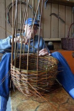 Bert Veld weaves a willow basket in his carport workshop in Sidney—Image Credit: Christine Van Reeuwyk