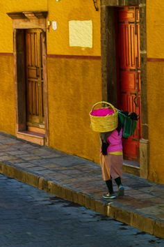 Basket Of Pink | Woman Walking In San Miguel De Allende | Guanajuato | Mexico | Photo By Manny Ramirez