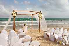 NOW Jade Riviera Cancun  Exactly how I want my ceremony set up !  Pink flowers and chair bows.