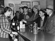 | Jim Fitzpatrick, Mrs Gleeson pours a beer for customers at the Drouin Hotel, Drouin, 1944 |
