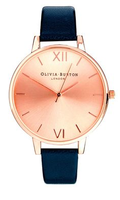 Olivia Burton Watch, rose gold and brown though. HOLY PERFECT £68