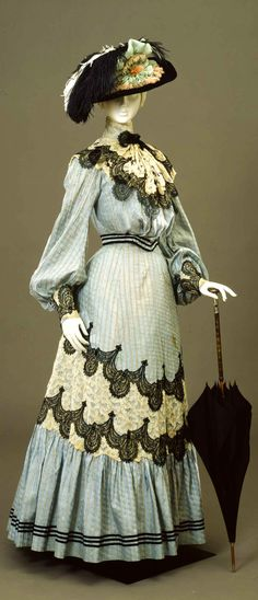 """Day dress, ca. 1904-1905 """"Turtleneck"""" or high neck style dresses were increasingly popular during the early 1900's. This elongated the neck, and created an elegant look. Wire supports were used to maintain this rigid effect."""