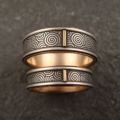 Down To The Wire Designs is known for beautiful wedding rings, often ornate with patterned designs and mixed metals along with other modern jewelry.