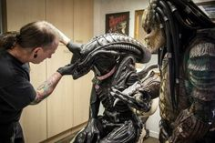 At this tattoo parlor, Alien and Predator are actually pretty good pals