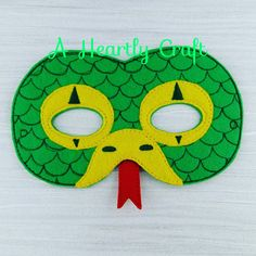Slithering Snake Mask Fun for kids from 3+. All masks come with a 11 elastic attached. Masks fit most toddlers and children. -Measures approximately 7 x 5 inches. -Made with two layers of eco felt, machine stitched and cut by hand. -Childrens Comes with 11 elastic attached. -Adults masks I will stitch in elastic measuring 16 Please note my current turn around time before purchasing and note the date needed by: in the Notes to Seller at checkout. I do ship abroad so please contact me with ...