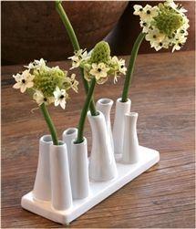 Ceramic Multi Tube Vase with rectangular base with short tubes.