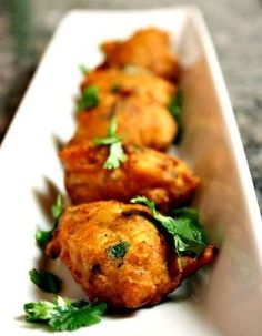 Vegetable Pakoras (potatoes, onion, green chili, parsley, cumin, coriander, salt, chili powder, chickpea flour, water and oil for frying)