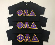 These Phi Alpha Delta Black Letters Shirts POP with Purple and Light Gold stitch letters. Design your own in the Letter Design Shop! Delta Greek Letter, Greek Letter Shirts, Greek Shirts, Fraternity Letters, Sorority Letters, Customize Your Own Shirt, Greek Gear, Custom Greek Apparel, Alpha Delta