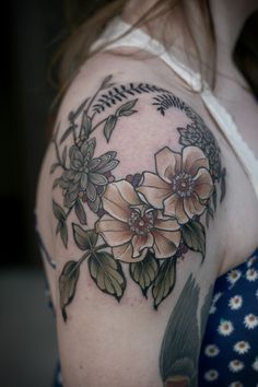 I like the flowers and the green leaf flower and the black fern-like leaves towards the top, as well as the colors
