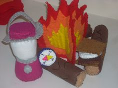 Felt campfire set complete with a lantern, smores, and a compass.