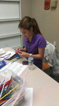 Teen participating in a maker craft at Cascades Library.
