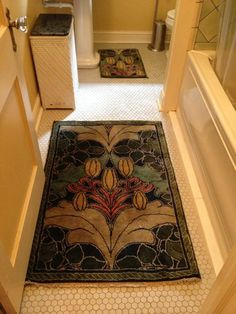 """One of our lucky clients in NC experiences the daily delight of sinking his toes into soft, plush, absorbent wool when he steps out of the shower. """"Lily & Vine"""" Arts and Crafts carpet design by C.F.A. Voysey, shown in the  Summer colorway of our authentic period palette.   See more at http://guildcraft.myshopify.com/collections/voysey-ss"""