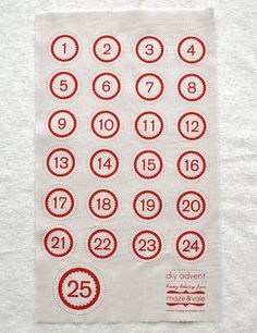 diy advent calendar numbers in perfect red on oatmeal linen cotton. $10.00, via Etsy.