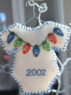 Personalized onesie Christmas ornament, boy colors - Made to order via Etsy