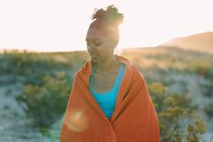 Thoughtful Woman Wrapped In Blanket On Sunny Day stock photo - OFFSET Sunny Day Pictures, Visa Gift Card, Model Release, Sunny Days, Sunnies, Clip Art, Social Media, Stock Photos, Thoughts