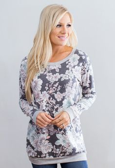 """We love florals and love wearing them all year round!! This french terry sweatshirt will keep you warm all fall and winter! 62% Polyester, 33% Rayon, 5% Spandex Made in the U.S.A<3 Model is 5'7"""" size"""