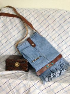 I handmade this purse from recycled jeans. It is lined with blue cow pattern. There are two small pockets on the inside, great for keys, cell phone