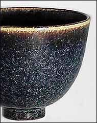 R626 Black with brown or blue dots.    A very good glaze. Apply rather thick. Works well in oxidation an then gives a semi transparent to opaque glaze with a lot of blue. In reduction it gives a more opaque glaze. You can use it on white porcelain to dark brown stoneware clays. On brown clays it must be very thick to give blue patches.       potash feldspar NR38,57  whiting5,71  barium carbonate8,57  talc2,86  ball clay 3028,57  quartz22,87  ilmenite7,14  zinc oxide5,71…