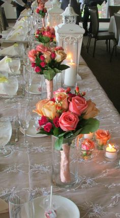 Idea for glass cylinders: put on table for bridesmaids to rest their bouquets while eating!!!