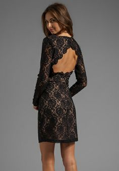 A sexy back! With a dress like this time to get that hair in a bun & work it with a red lipstick!