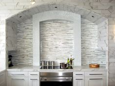 Like the colors in this back splash.  With dark cabinets and light counters.  Very nice!